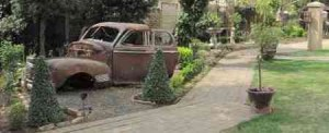 Guesthouse Bethlehem Garden Old Car 300x122 Home
